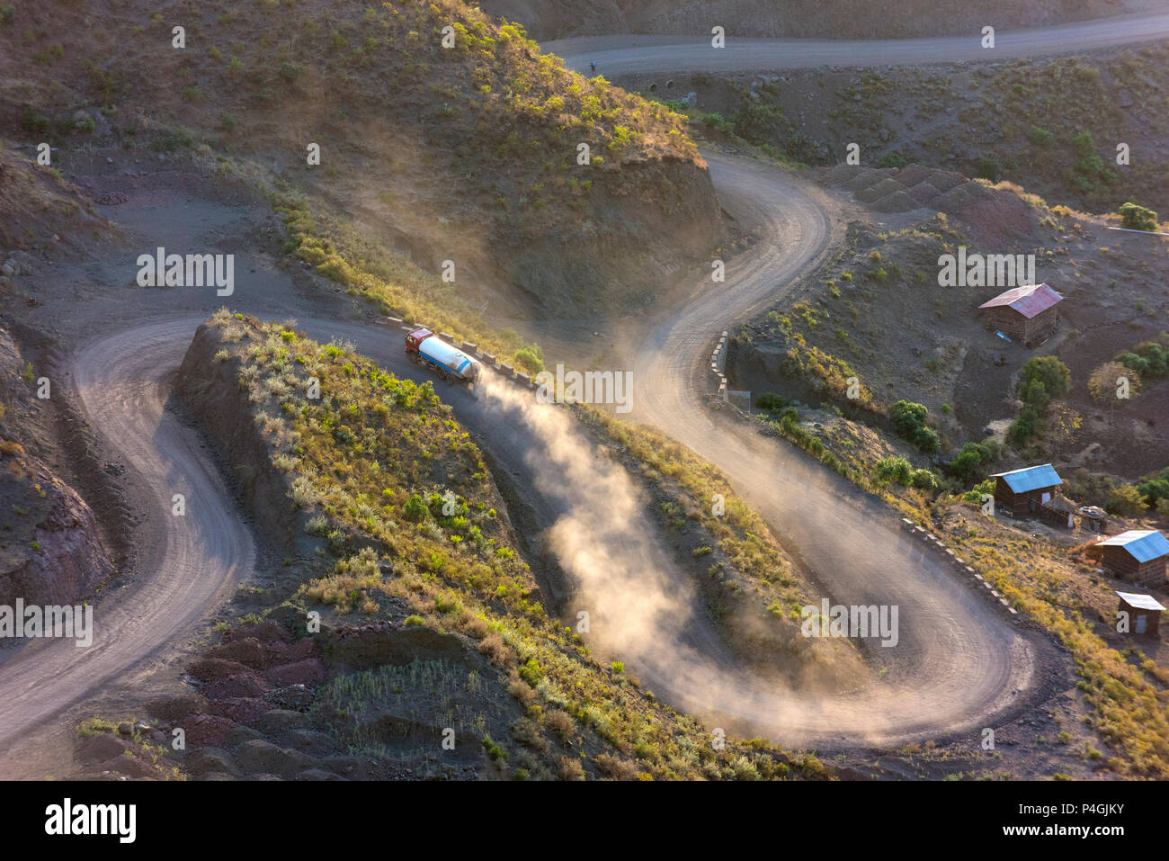 A truck winds its way up an unsealed road to Lalibela late in the afternoon. - Stock Image