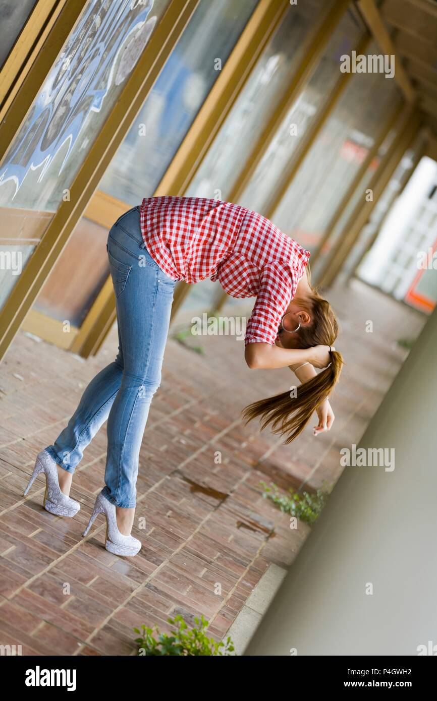 Teenager female wearing stiletto big high heels shoes pumps is model-released release image photo photography photograph alpfabet - Stock Image