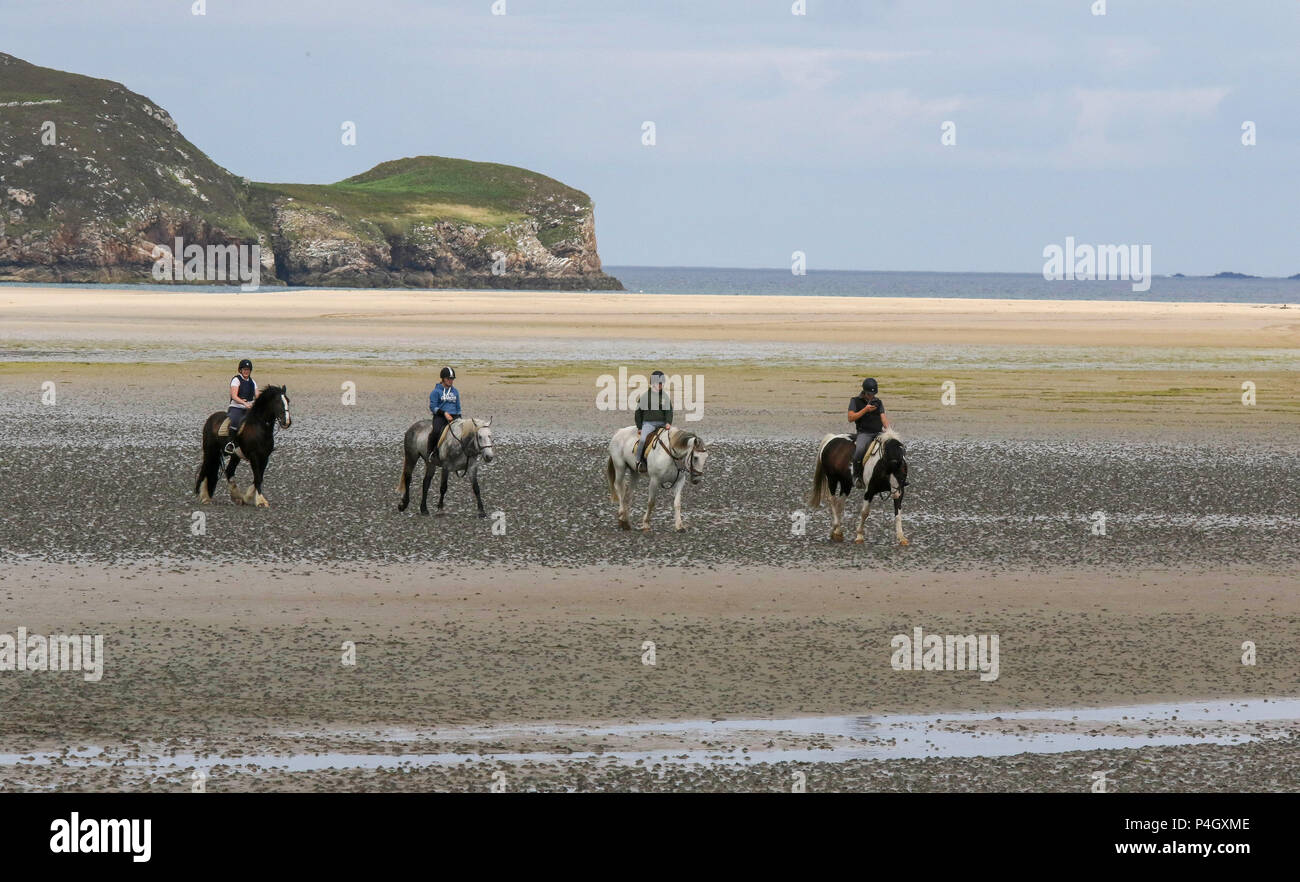 Four horses and riders on the beach at Dunfanaghy County Donegal Ireland - Stock Image