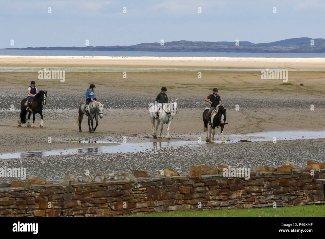 Riding school on a sandy beach in Ireland at Dunfanaghy County Donegal. - Stock Image