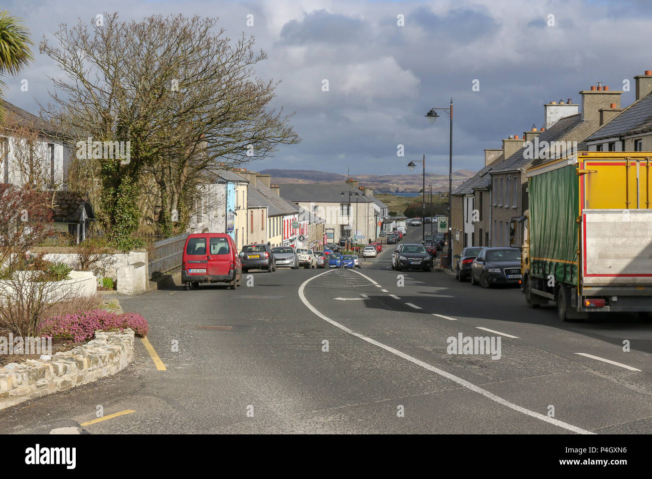 The long main street in Dunfanaghy - a popular village in County Donegal with Sheephaven Bay at the end of the .street. - Stock Image