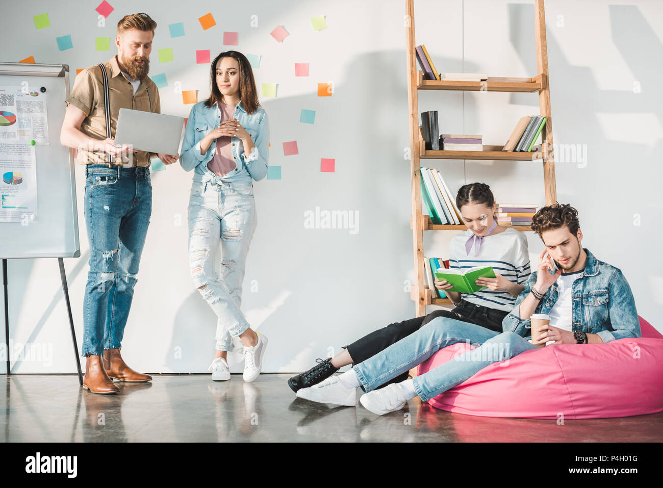 Professional business colleagues men and women during new ideas researching in modern office - Stock Image
