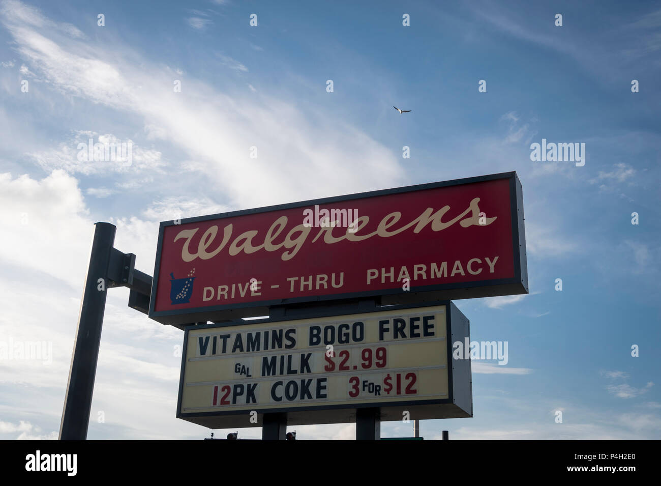 Walgreens Drive Thru Pharmacy Sign Above An Intersection Stock