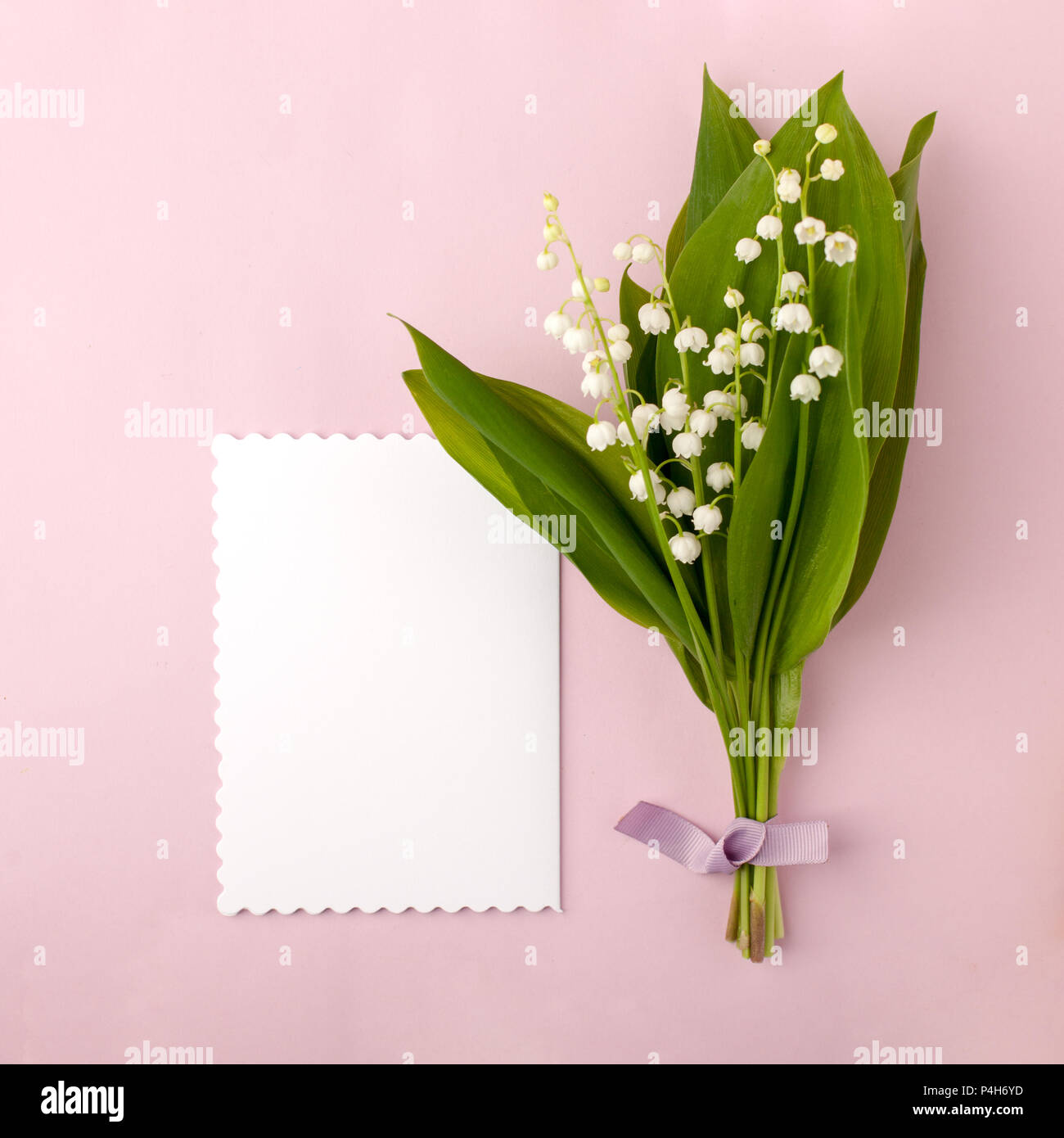 Bouquet of flowers lily of the valley and blank with red heart on bouquet of flowers lily of the valley and blank with red heart on pink pastel background beautiful breakfast vintage romantic card top view flat l izmirmasajfo