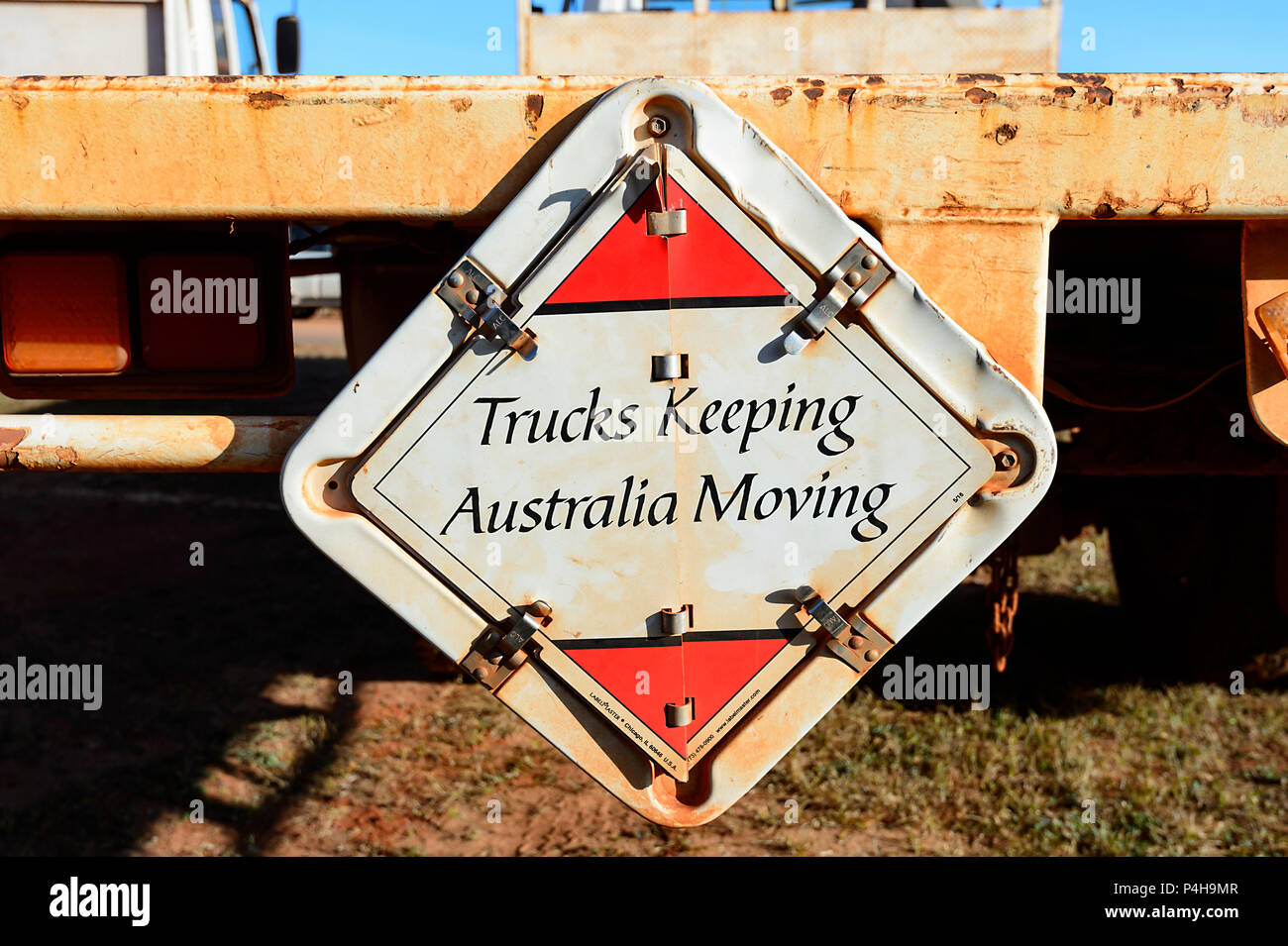 'Trucks keeping Australia moving' sign attached to the back of a truck, Australia - Stock Image
