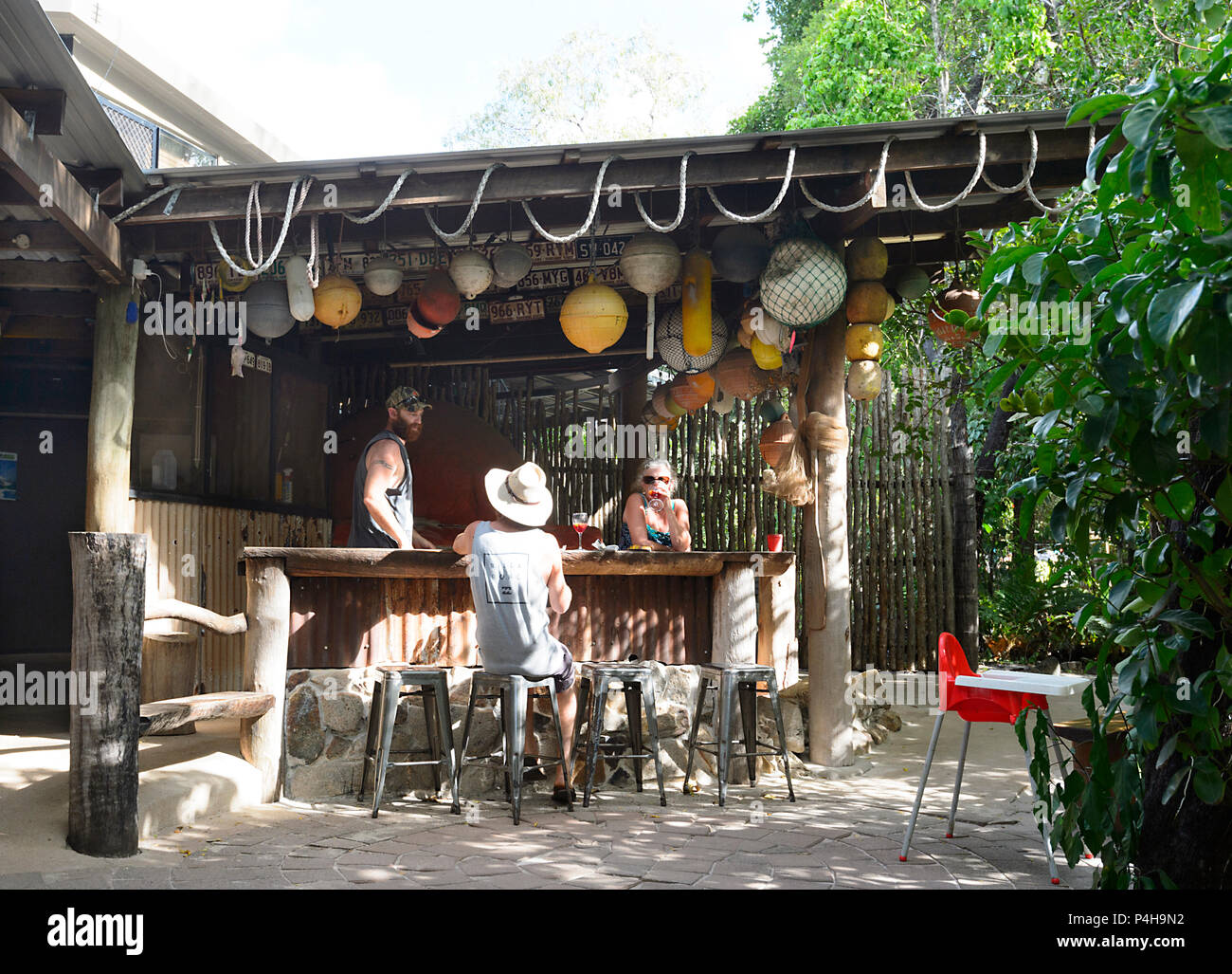 People relaxing at the bar at Punsand Bay camping, Cape York Peninsula, Far North Queensland, FNQ, QLD, Australia - Stock Image