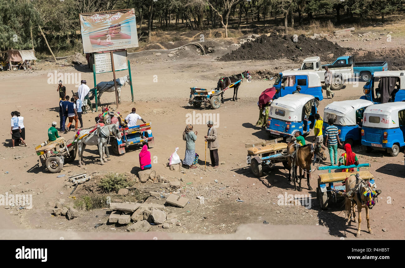 Addis Ababa, Ethiopia, January 30, 2014, Donkey-carts and taxis on the side of the road - Stock Image