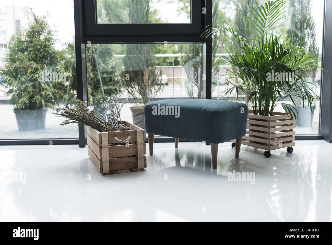 interior of empty creative office with chair and dry flowers in wooden box - Stock Image