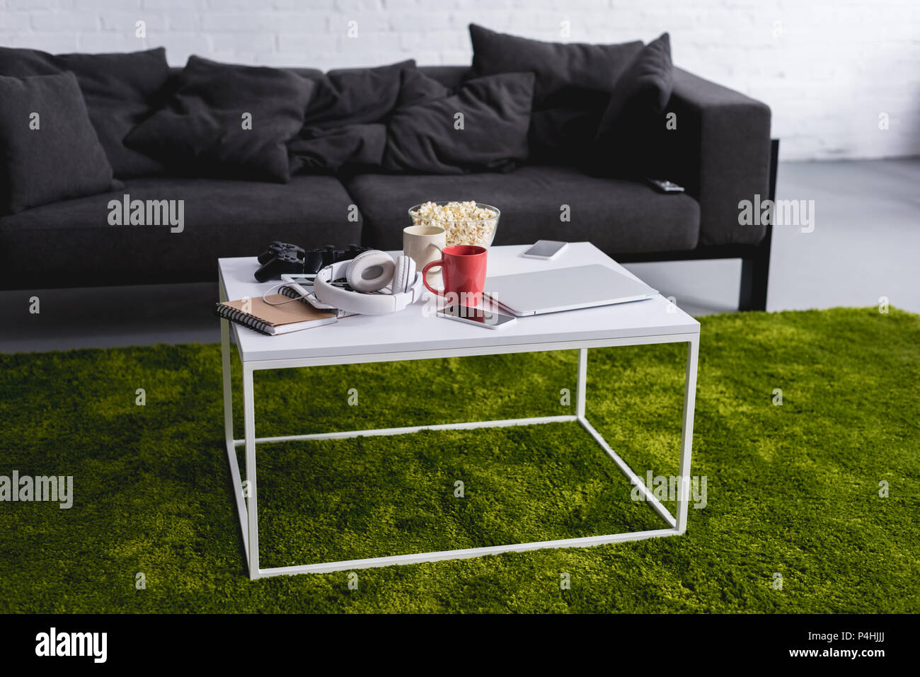 Grey Sofa And White Table With Green Carpet In Living Room Stock Photo Alamy
