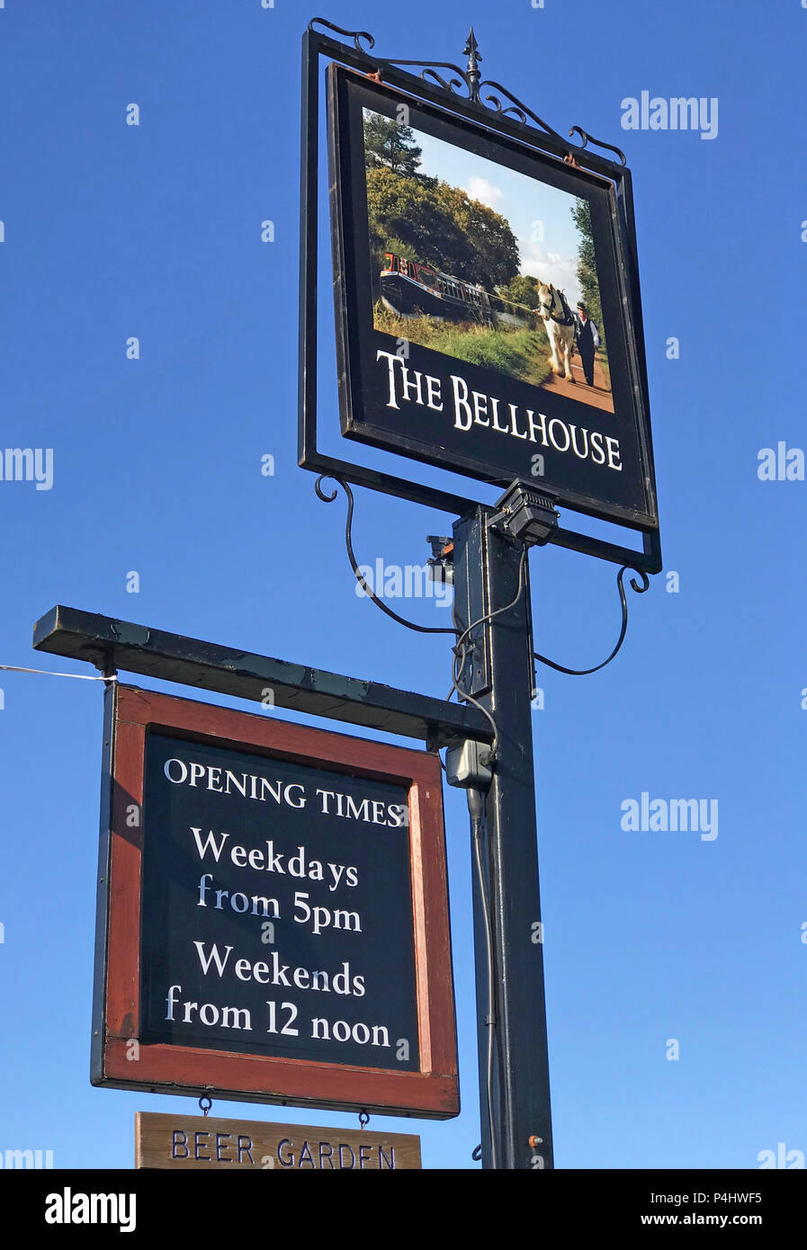 The Bellhouse Club Sign, opening hours,weekdays from 5pm,Weekends from 12 noon, Bellhouse lane,Grappenhall,Warrington,Cheshire Stock Photo