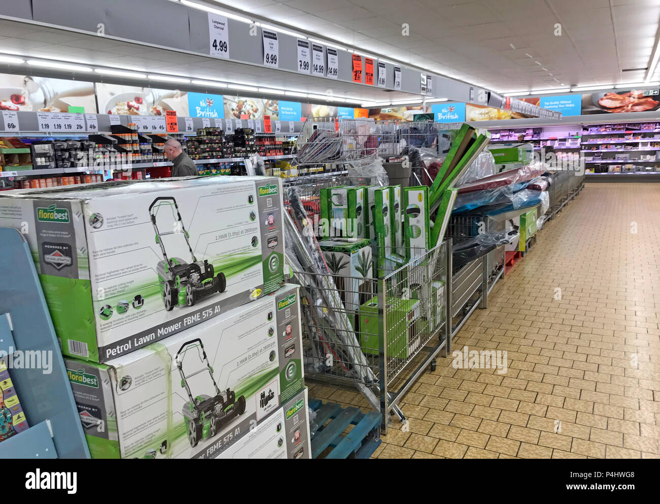 The Middle Aisle at Lidl, pop out for some spuds & come home with a lawnmower and some fishing waders, Latchford, Warrington, Cheshire, England - Stock Image