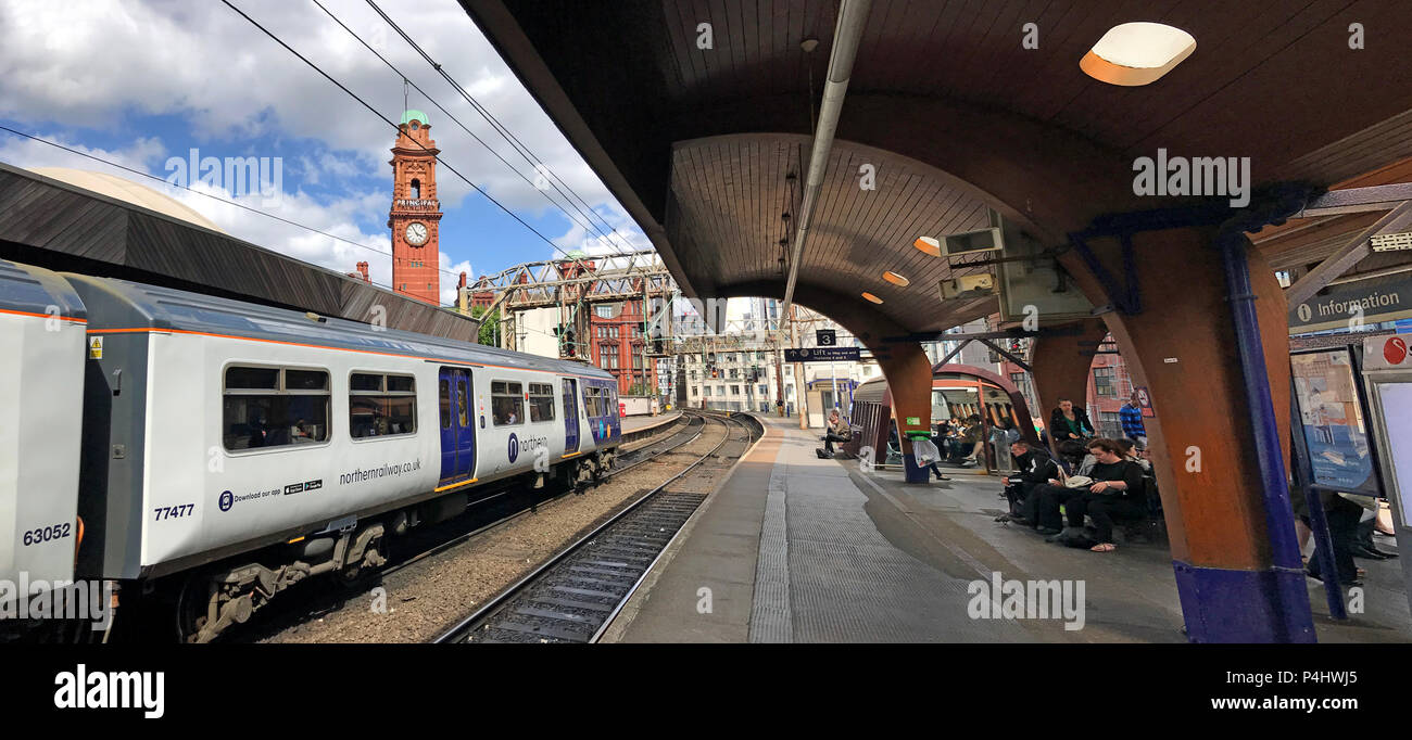 Delayed Electric Northern Railway EMU train at Manchester Oxford Road Railway station, North West England, UK - Stock Image