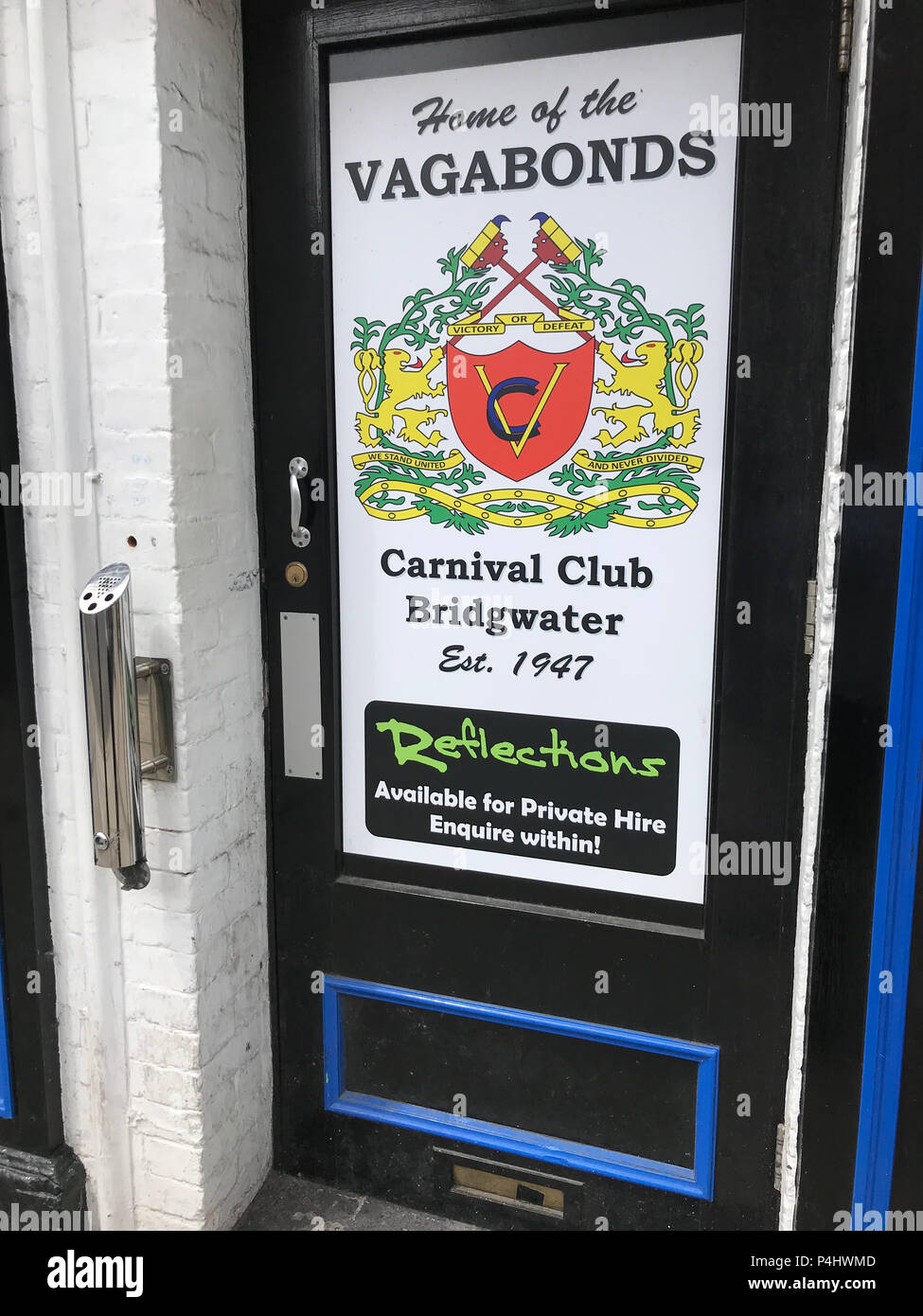 Home of the Vagabonds Carnival Club, high st, Bridgwater - Reflections Club door, Bridgwater Town, Somerset, England, UK Stock Photo