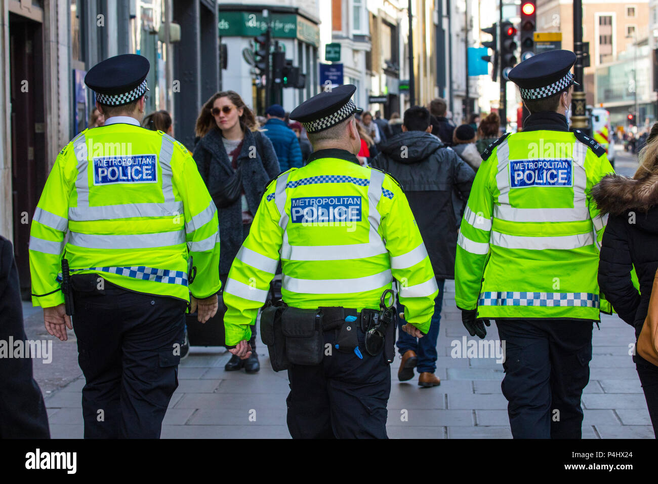 LONDON, UK - FEBRUARY 16TH 2018: Metropolitan Police Officers walking down Oxford Street in central London, on 16th February 2018. - Stock Image