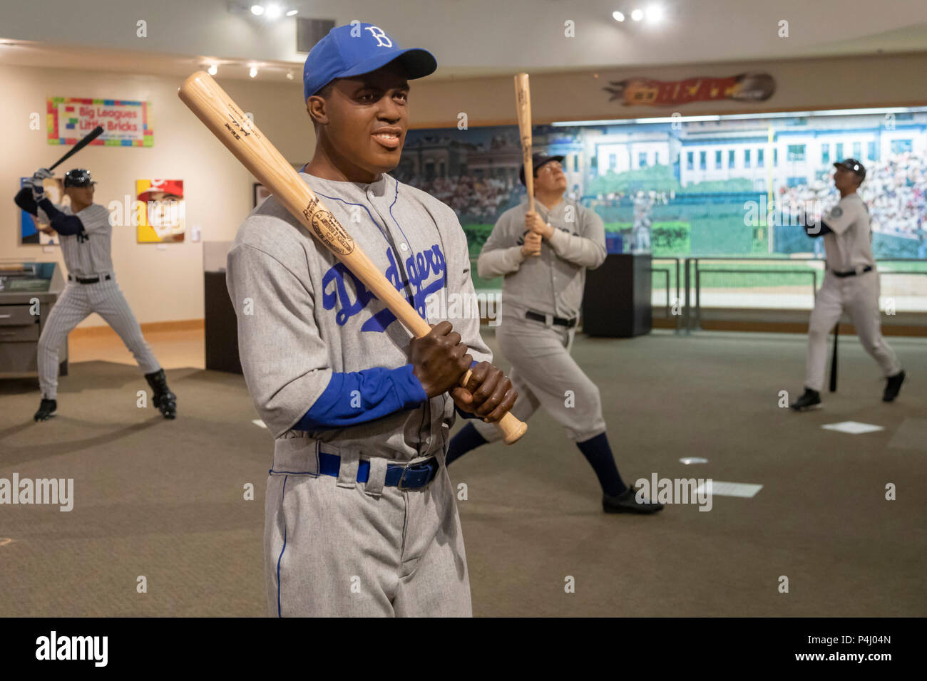 Louisville, Kentucky - A sculpture of Jackie Robinson with his baseball bat at the Louisville Slugger Museum and Factory. - Stock Image