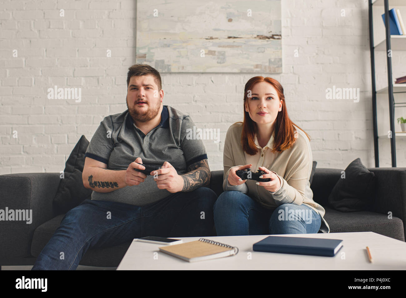 boyfriend and girlfriend playing video game at home