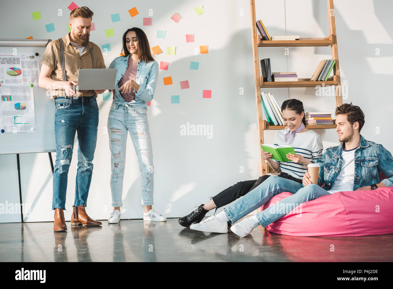 Professional business colleagues men and women in modern office with white board - Stock Image