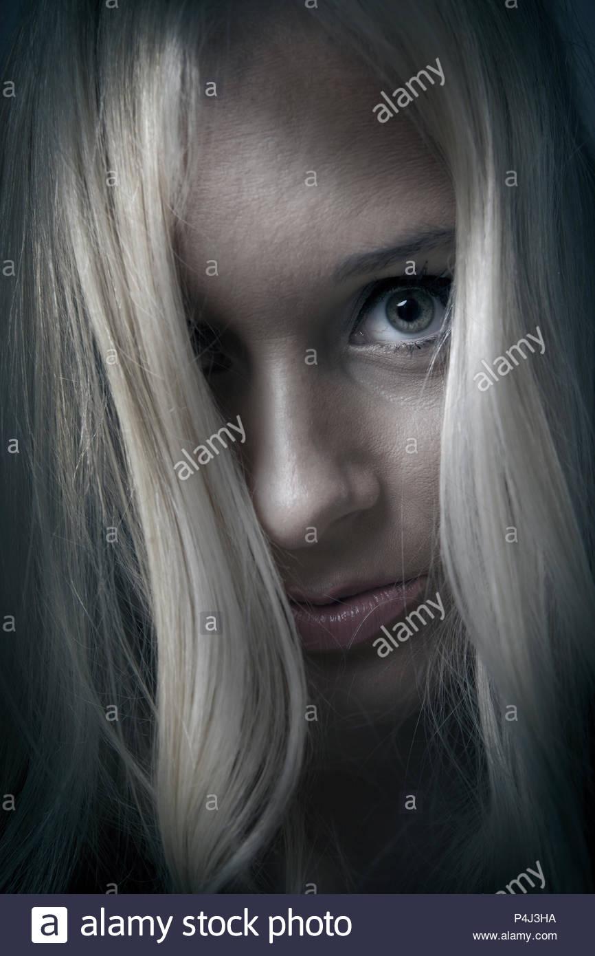 Woman face closeup in mental health portrait - Stock Image