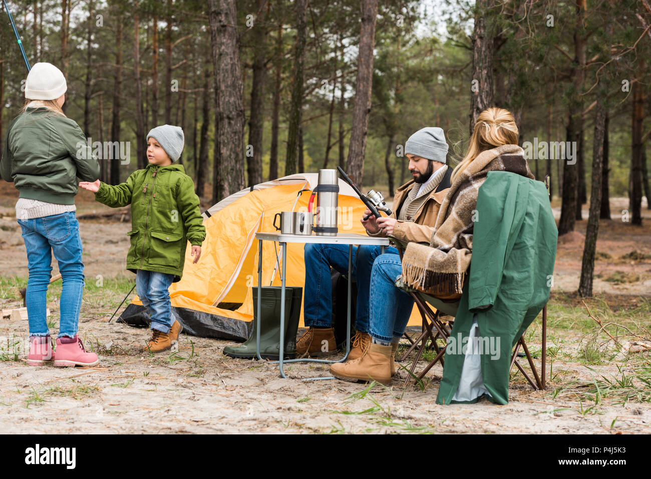 happy young family on camping in forest - Stock Image