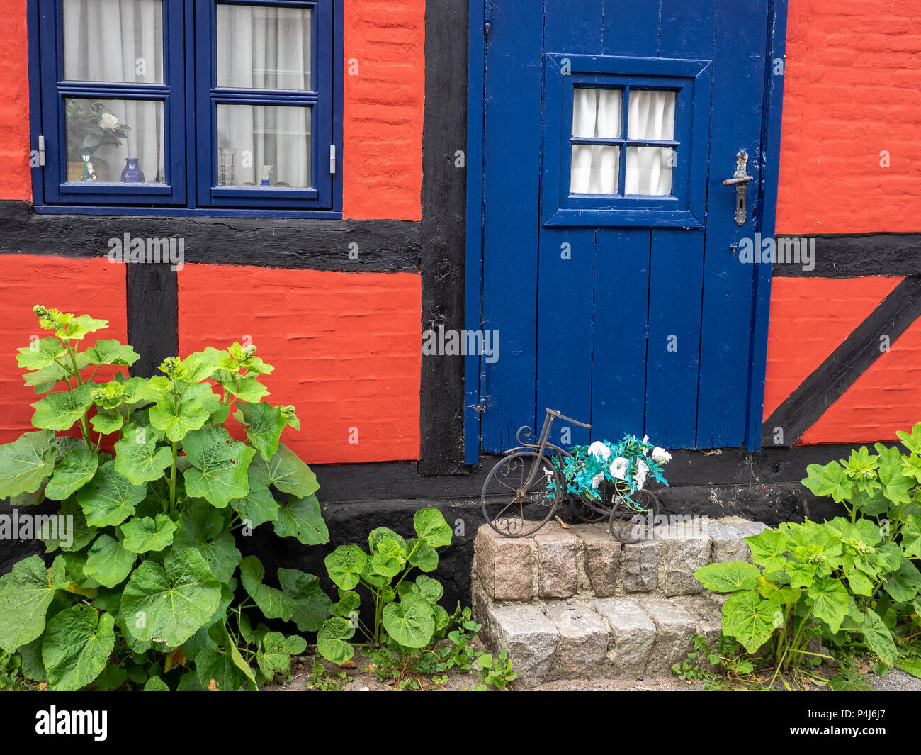 Colorful blue, red and black cottage in Marstal, Aero Island, Denmark - Stock Image