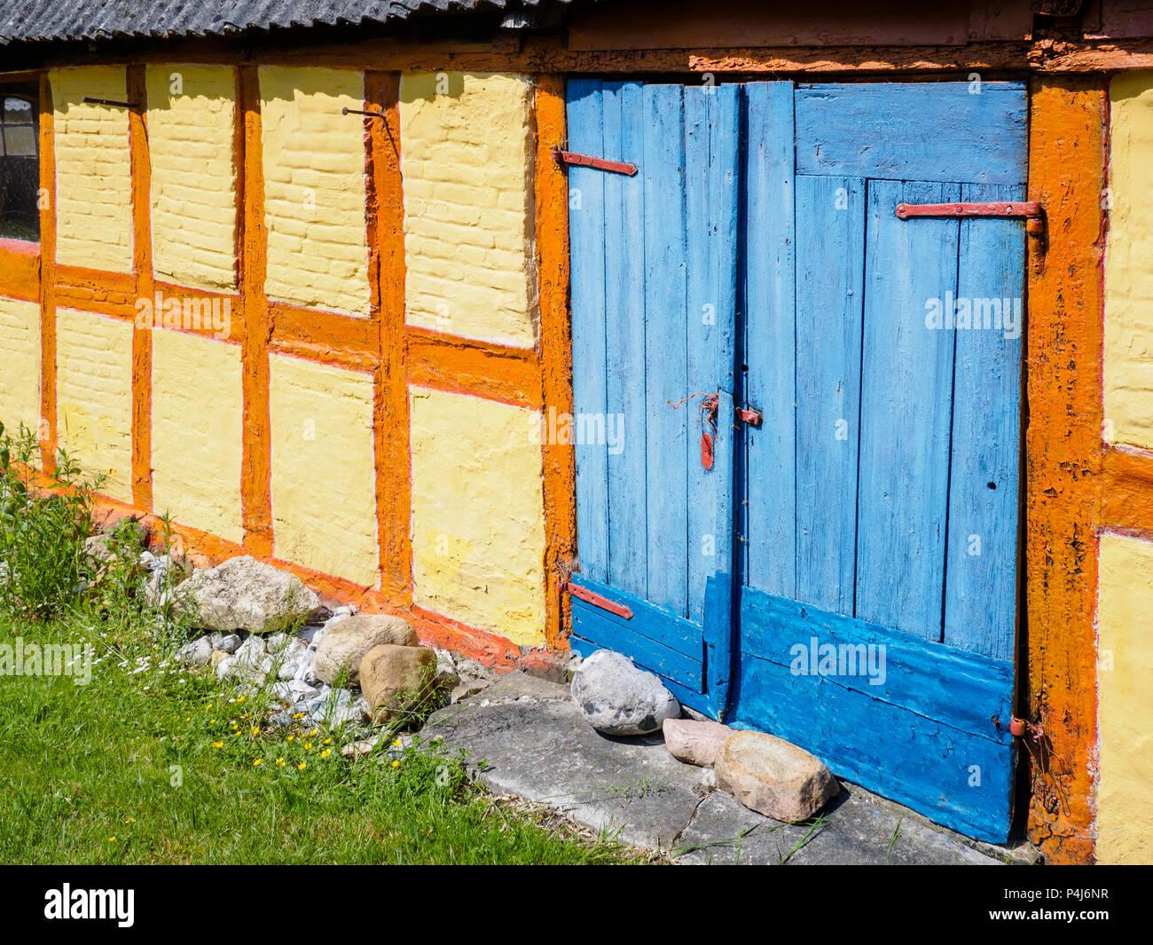 Colorful yellow, orange and blue cottage, Soby, Aero Island, Denmark Stock Photo