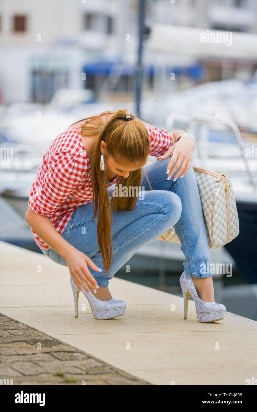Teenager female wearing stiletto high heels shoes - Stock Image