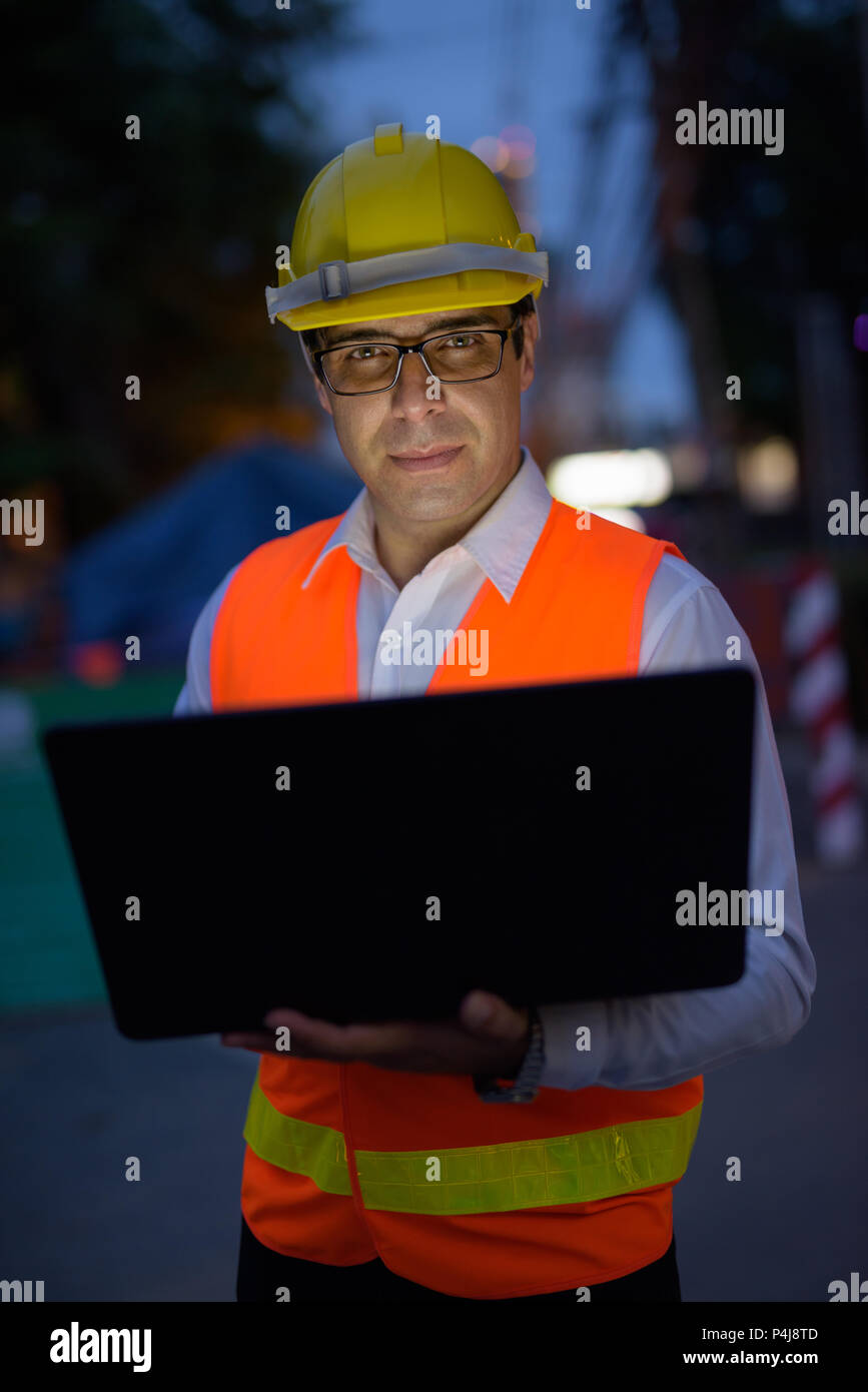 Handsome Persian man construction worker at the construction sit - Stock Image