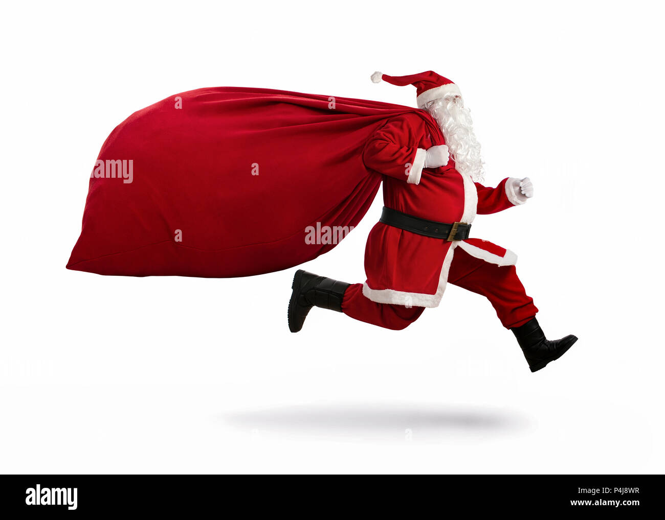 Santa Claus on the run to delivery christmas gifts isolated on white background - Stock Image