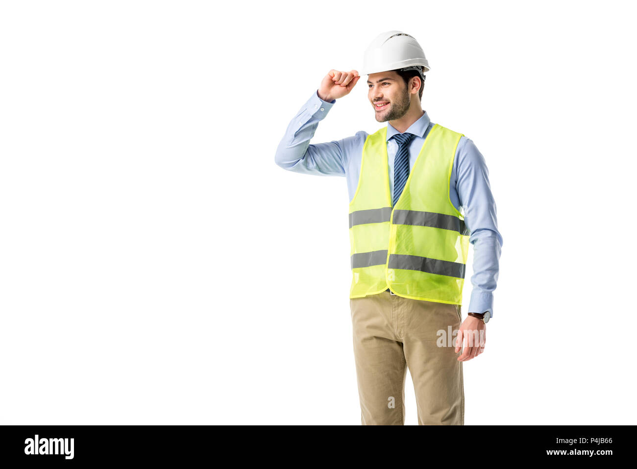 Smiling builder in reflective vest wearing helmet isolated on white - Stock Image