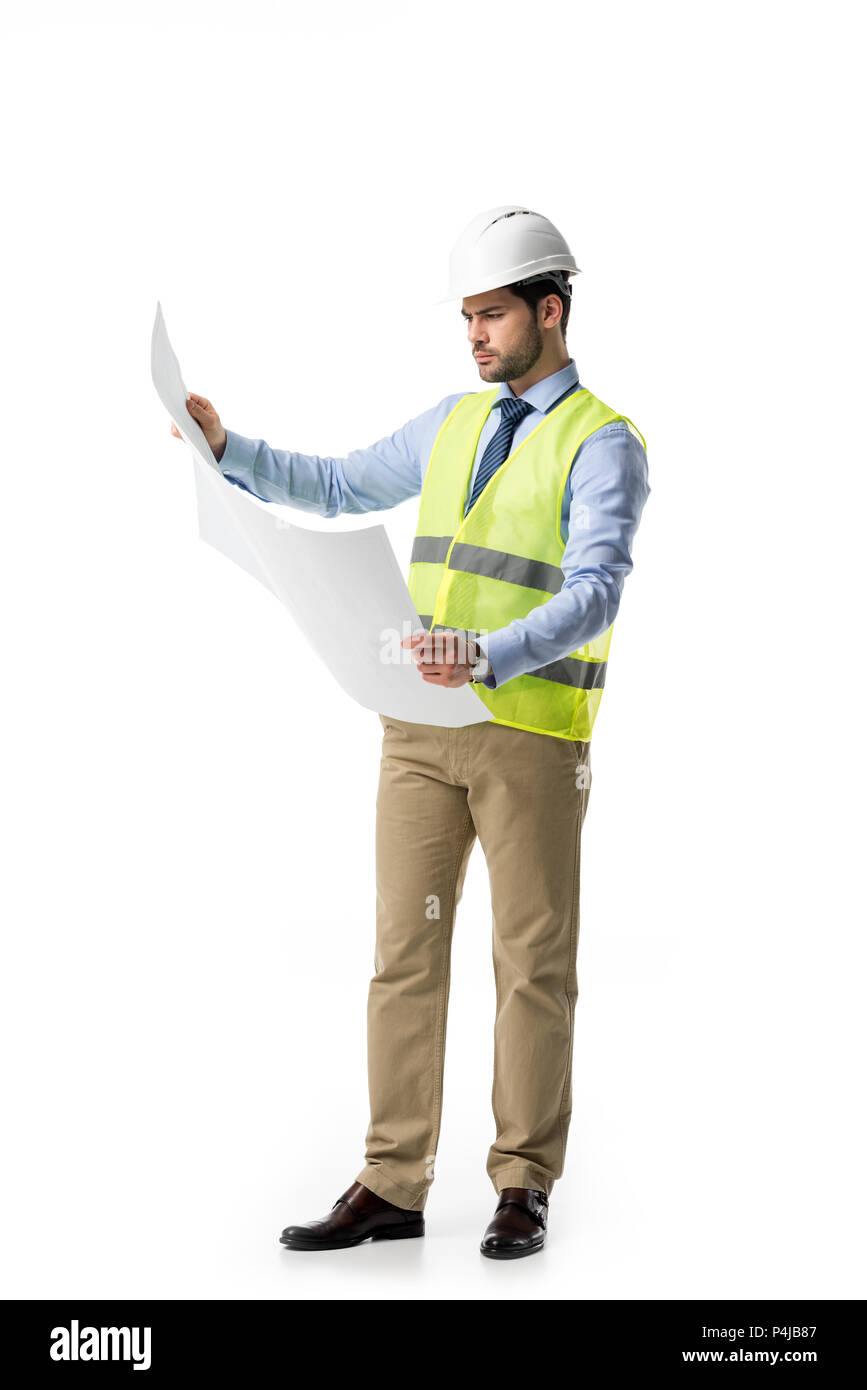 Architect in reflective vest and hardhat looking at blueprint isolated on white - Stock Image