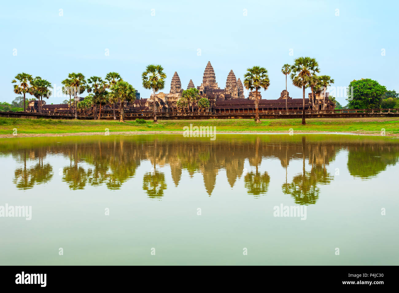 Angkor Wat temple in Siem Reap in Cambodia at sunset. Angkor Wat is the largest religious monument in the world. - Stock Image