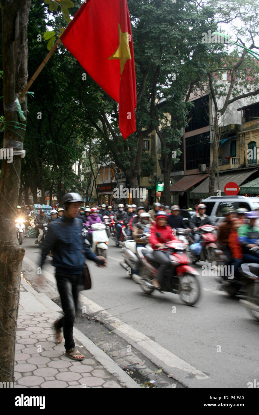 Busy Street Scene with Bikes and Motorbikes, Hanoi, Vietnam - Stock Image