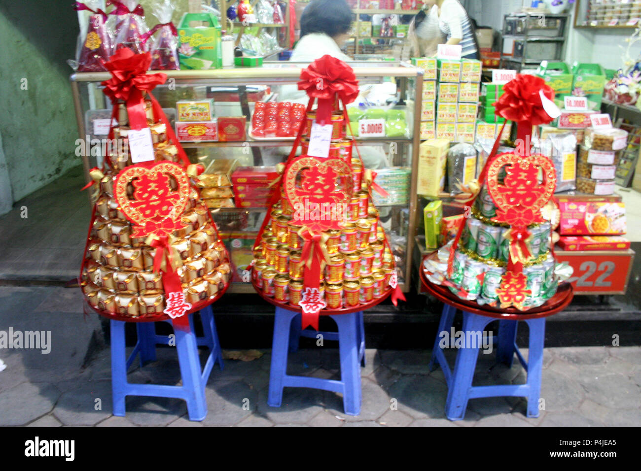 Display Tied with Red Bows outside shop, Hanoi, Vietnam - Stock Image