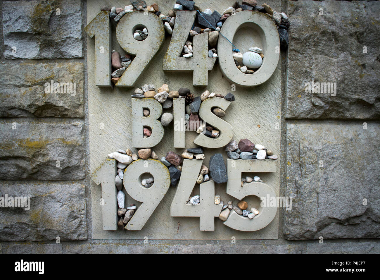 Memorial stone at the entrance to the historical camp area at Bergen-Belsen concentration camp grounds today. - Stock Image