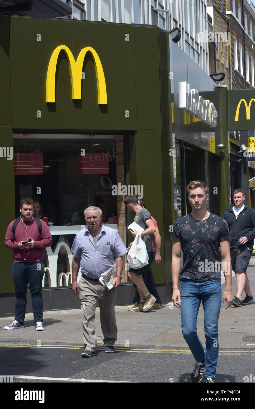 An outlet of fast food american hamburger franchise McDonalds in Kentish Town, North London. - Stock Image