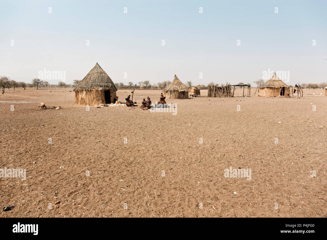 Himba village with traditional huts near Etosha National Park in Namibia, Africa - Stock Image