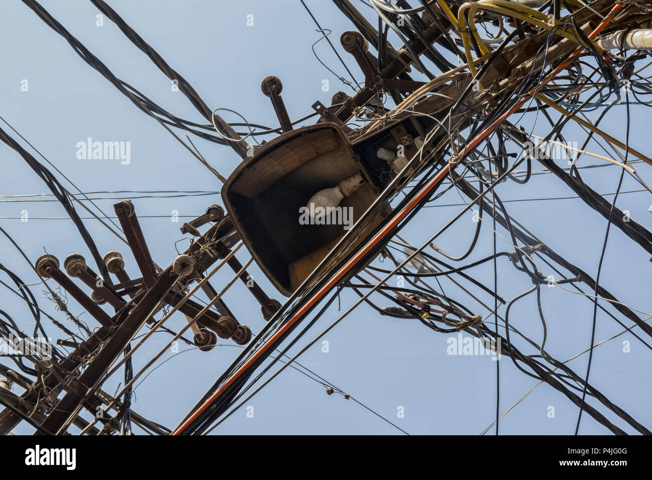 Messy wires attached to the electric pole, the chaos of cables and wires on an electric pole in Bangkok, Thailand, concept of electricity - Stock Image