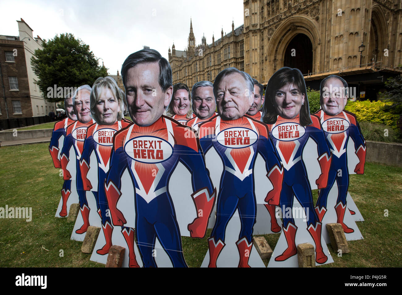 15 superhero cutouts with faces of key Tory rebel MPs outside Parliament ahead of Wednesday's Commons vote to give Parliament a vote on Brexit. - Stock Image