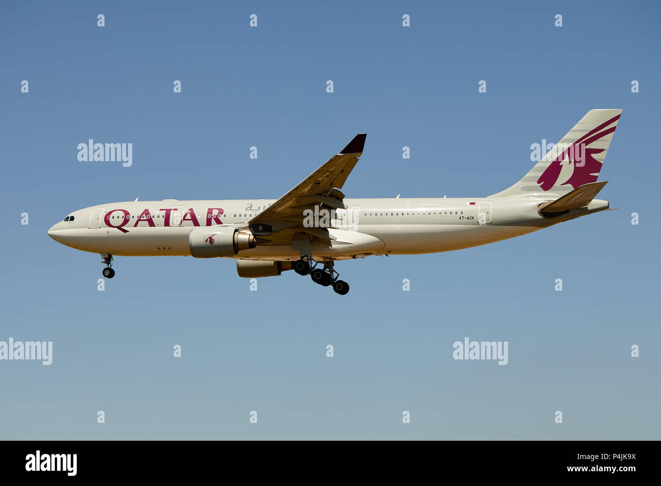 A Qatar Airways Airbus A330-202 aircraft, registration number A7-ACK, approaching a landing. - Stock Image