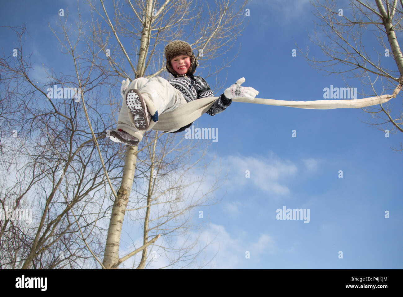 Child on the Rope Swing - Stock Image