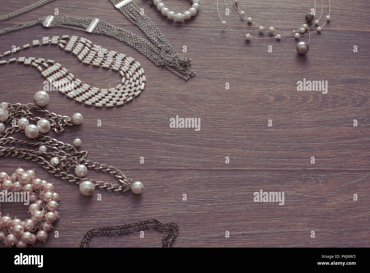 29153ee2175f03 Set of vintage jewelry on a dark wooden background. Necklace pearl cameo  locket watch view from the top Flat lay