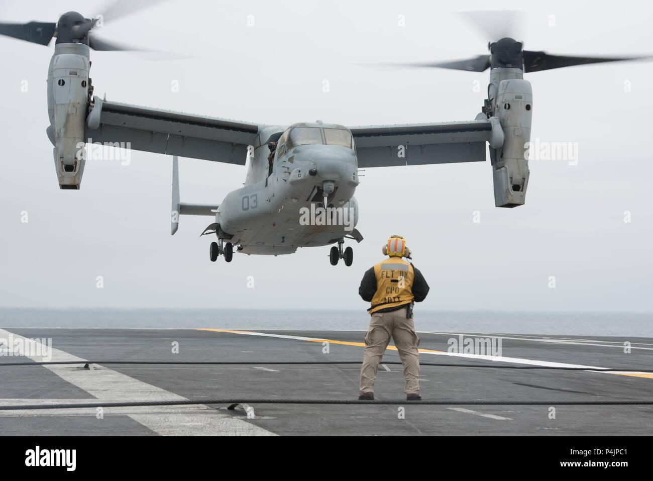 180620-N-GU969-0090  PACIFIC OCEAN (June 20, 2018) An MV-22B Osprey assigned to Marine Medium Tiltrotor Squadron (VMM) 363, Third Marine Aircraft Wing (3rd MAW), prepares to land on the flight deck of the Nimitz-class aircraft carrier USS John C. Stennis (CVN 74). John C. Stennis is underway preparing for its next scheduled deployment. (U.S. Navy photo by Mass Communication Specialist 3rd Class William Rosencrans/Released) Stock Photo