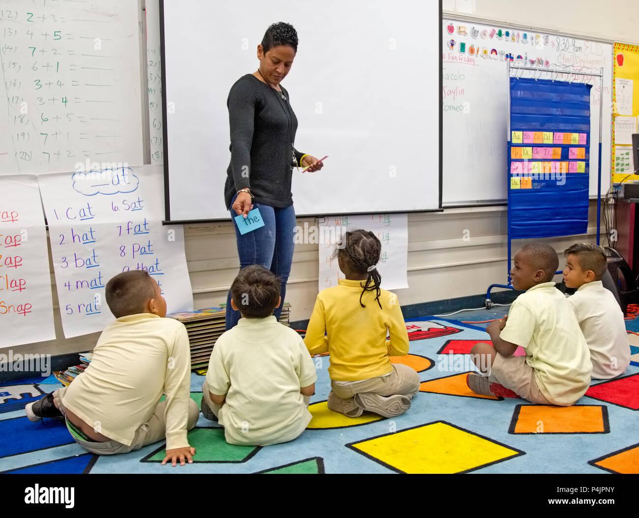 Kindergarten Teacher and Students - Stock Image