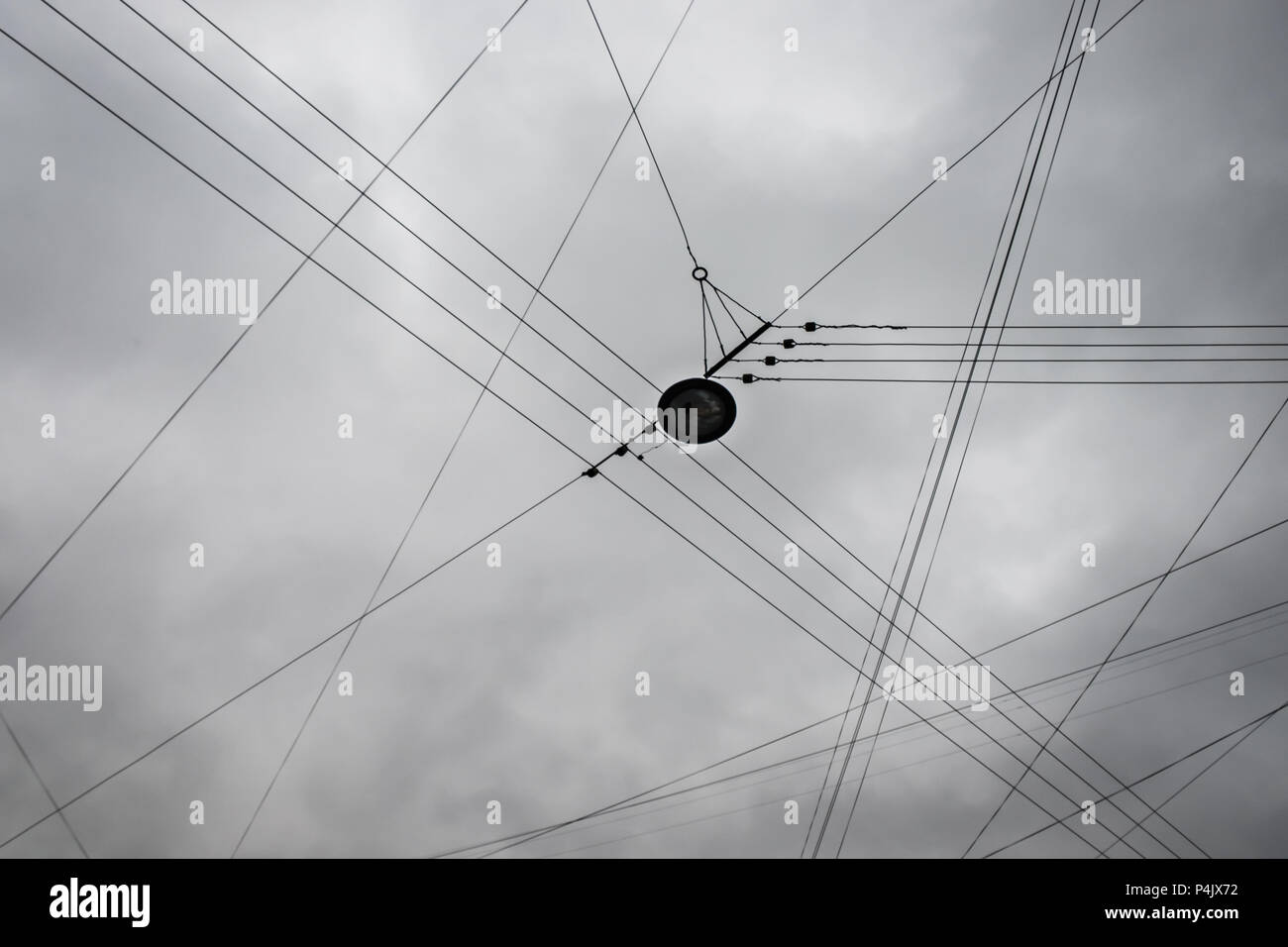Electric Wires On Autumn Overcast Gray Cloud Sky Background. Abstract Template For Design With Copy Space. - Stock Image