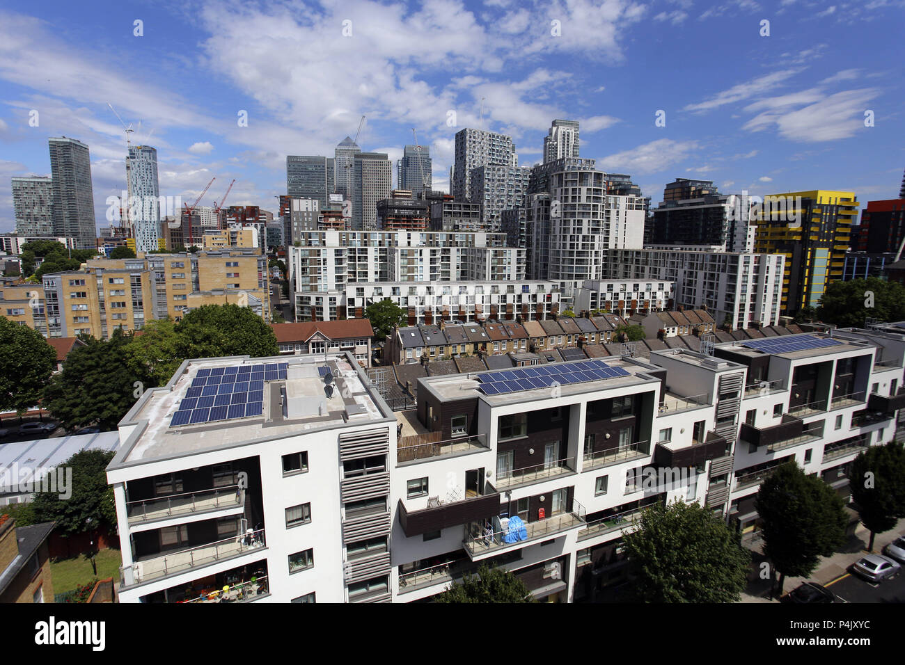 Residential Apartments with rooftop solar panels near Canary Wharf, Isle of Dogs, London, - Stock Image