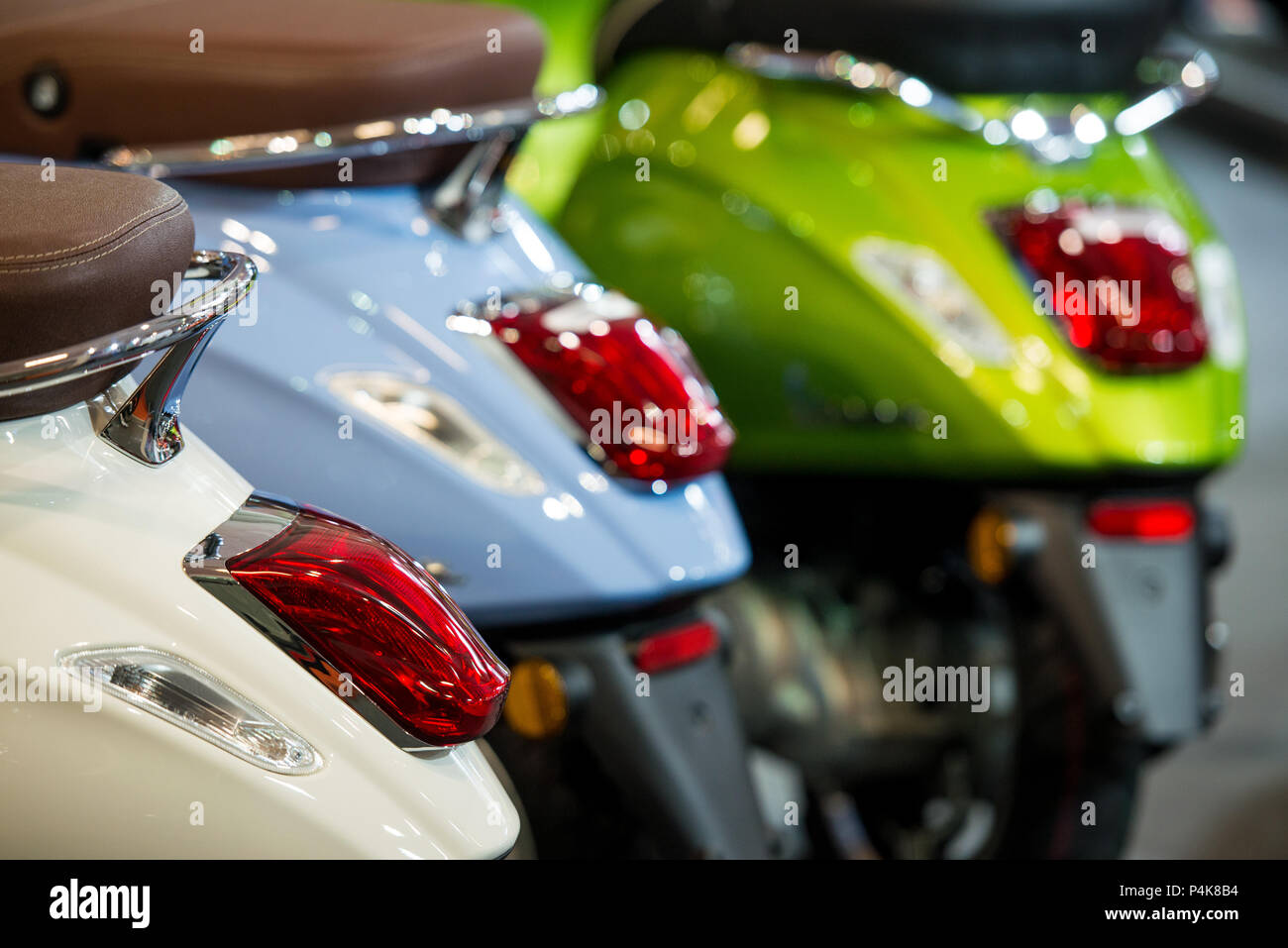 Detail of motorcycle stoplights on three retro scooters - Stock Image