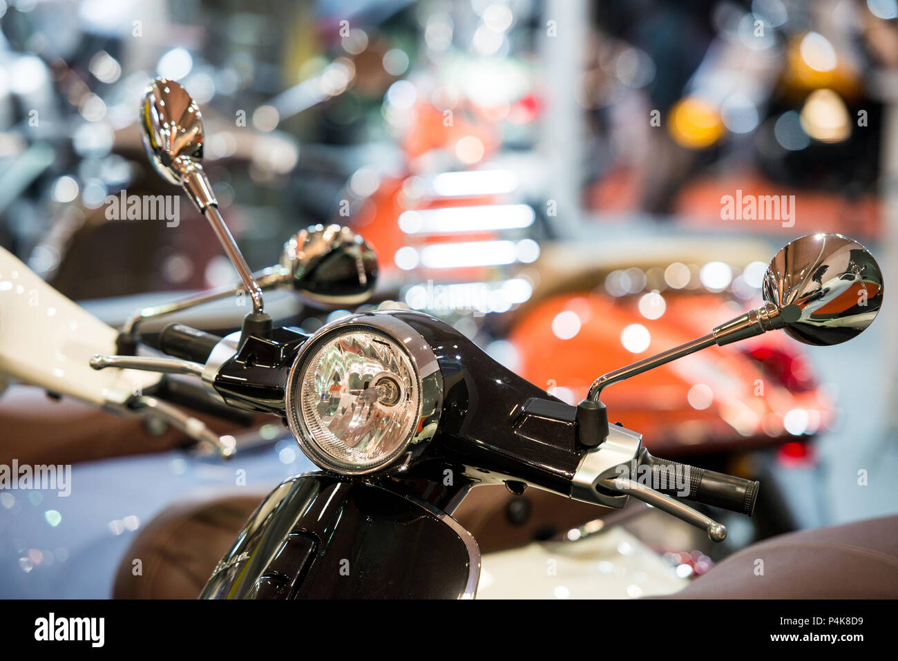 Detail of small motorcycle headlight and mirrors on handlebar - Stock Image