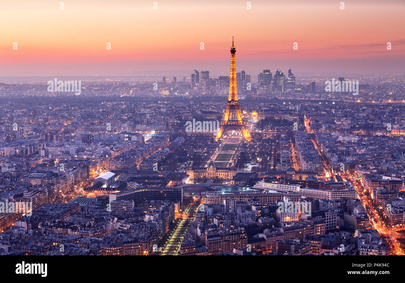 PARIS - FEBRUARY 7: Eiffel Tower brightly illuminated at dusk on FEBRUARY 7, 2015 in Paris. The Eiffel tower is the most visited monument of France. Stock Photo