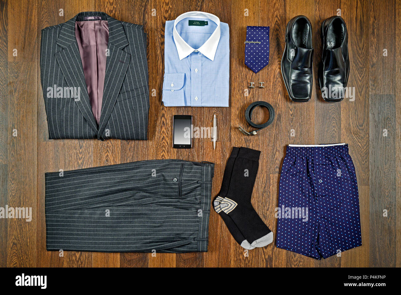 A Flat Lay Arrangement Of Mens Business Attire With Grey Pin Striped