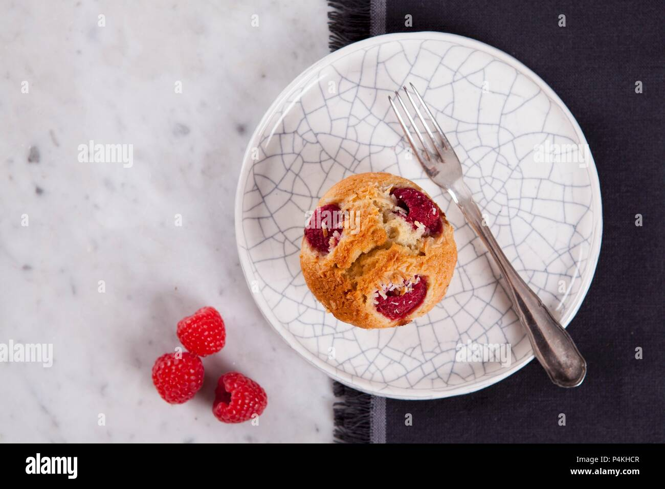 A raspberry financier with coconut - Stock Image